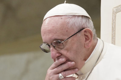 In this Aug. 22, 2018 file photo, Pope Francis is caught in pensive mood during his weekly general audience in the Pope Paul VI hall, at the Vatican. (Andrew Medichini/AP)