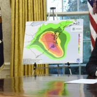 President Donald Trump, right, and Vice President Mike Pence, left, listen during a briefing on Hurricane Florence in the Oval Office of the White House in Washington, Tuesday, Sept. 11, 2018. (AP Photo/Susan Walsh)