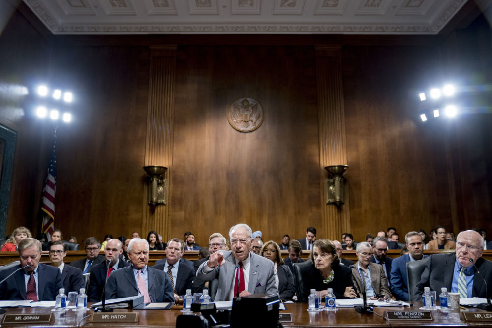 Senate Judiciary Committee Chairman Chuck Grassley, R-Iowa, center, accompanied by Sen. Lindsey Graham, R-S.C., left, Sen. Orrin Hatch, R-Utah, second from left, Sen. Dianne Feinstein, D-Calif., the ranking member, second from right, and Sen. Patrick Leahy, D-Vt., right, speaks during a Senate Judiciary Committee markup meeting on Capitol Hill, Thursday, Sept. 13, 2018, in Washington. (Andrew Harnik/AP)