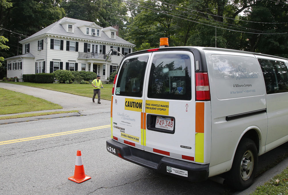 An employee of Columbia Gas leaves a house after shutting off the gas Friday in Andover. (Winslow Townson/AP)
