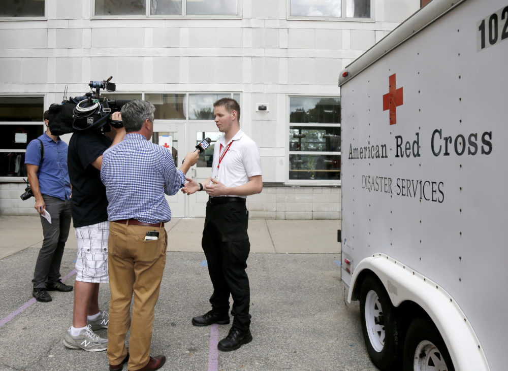 Red Cross employee Larry French briefs the media outside the Parthum School in Lawrence, Mass., Friday, Sept. 14, 2018. (Mary Schwalm/AP)