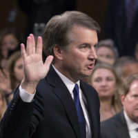 President Donald Trump's Supreme Court nominee, Brett Kavanaugh, raises his right hand as he is sworn in before the Senate Judiciary Committee for his confirmation hearing, on Capitol Hill in Washington, Tuesday, Sept. 4, 2018.  (AP Photo/J. Scott Applewhite)