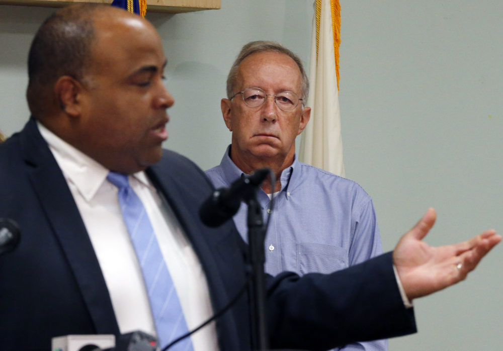 Columbia Gas of Massachusetts President Steve Bryant, right, listened to Lawrence Mayor Dan Rivera at a news conference in September 2018. Bryant will retire on May. 1. (Elise Amendola/AP)