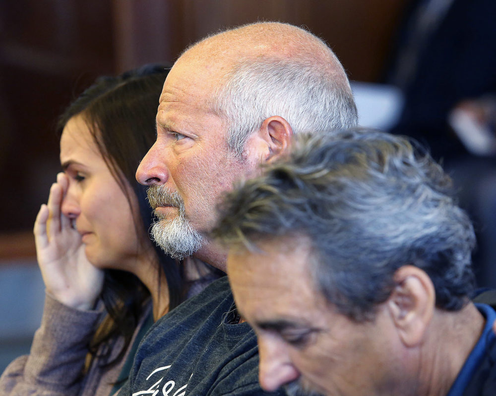 Family members of victim Shana Warner, from left, daughter Victoria Taylor, boyfriend John Tallent and father Tom DeFilippo, listen during the arraignment of her husband, Allen Warner, 47 in Plymouth District Court in Plymouth, Mass., on Wednesday, Sept.26, 2018. (Greg Derr/The Quincy Patriot Ledger via AP)