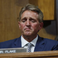 Sen. Jeff Flake, R-Ariz., after speaking during the Senate Judiciary Committee hearing about an investigation, Friday, Sept. 28, 2018 on Capitol Hill in Washington. After a flurry of last-minute negotiations, the Senate Judiciary Committee advanced Brett Kavanaugh's nomination for the Supreme Court after agreeing to a late call from Sen. Flake for a one week investigation into sexual assault allegation against the high court nominee. (AP Photo/Pablo Martinez Monsivais)