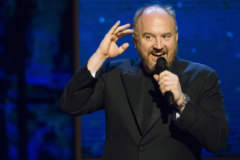 "Louis C.K. appears onstage at Comedy Central's ""Night of Too Many Stars: America Comes Together for Autism Programs"" at the Beacon Theatre on Saturday, Feb. 28, 2015 in New York. (Charles Sykes/Invision/AP)"
