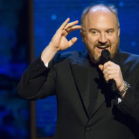 """Louis C.K. appears onstage at Comedy Central's """"Night of Too Many Stars: America Comes Together for Autism Programs"""" at the Beacon Theatre on Saturday, Feb. 28, 2015 in New York. (Charles Sykes/Invision/AP)"""