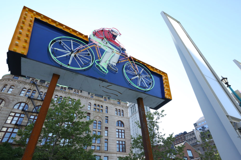 "The ""Cycle Center"" neon sign on the Greenway. (Courtesy Rose Kennedy Greenway)"