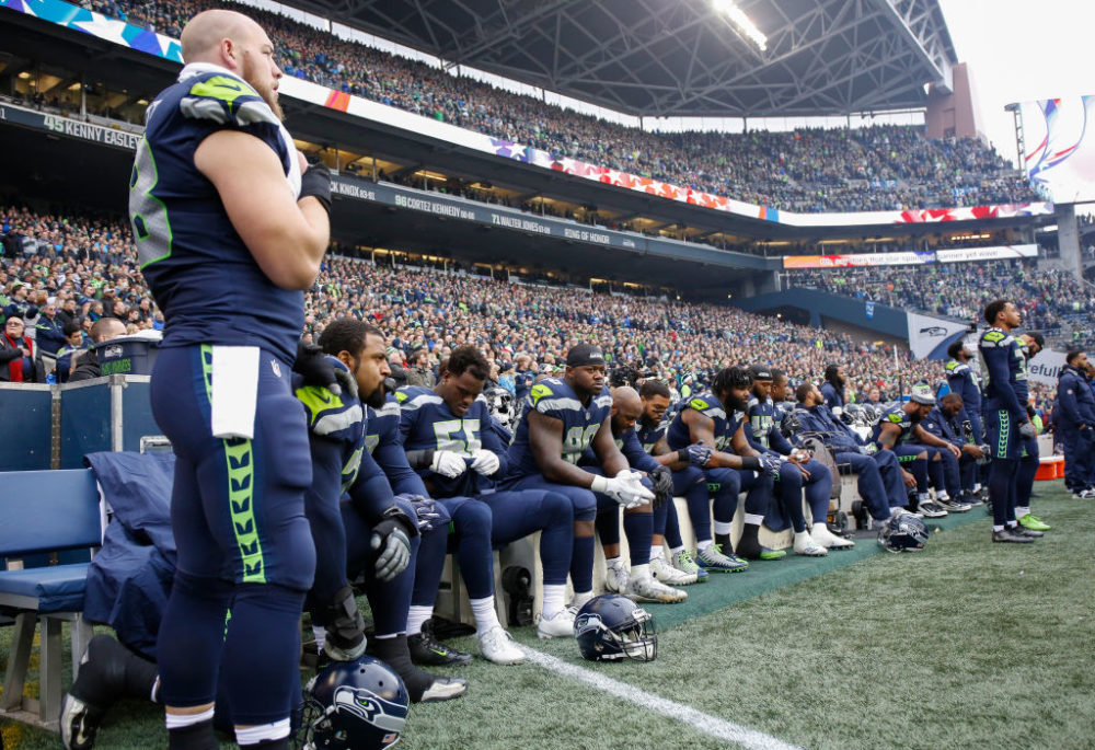 Members of the Seattle Seahawks sit for the national anthem before the game against the Los Angeles Rams on December 17, 2017.  (Otto Greule Jr/Getty Images)