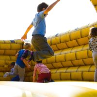 Children play in a bounce house. (Pexels)