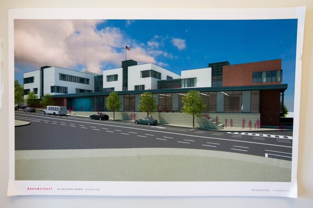 A rendering of the proposed new high school at 361 Belgrade Ave., hanging in the doorway of the Maywood campus. (Jesse Costa/WBUR)