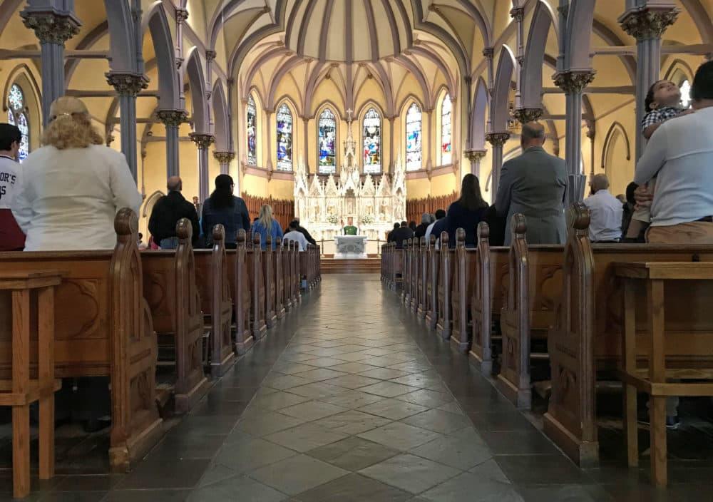 Rev. Paul O'Brien led mass at St. Patrick Parish in Lawrence Sept. 23. (Callum Borchers/WBUR)