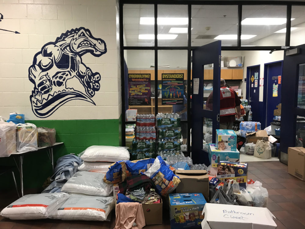 Donations at the shelter at Arlington Middle School in Lawrence (Shannon Dooling/WBUR)