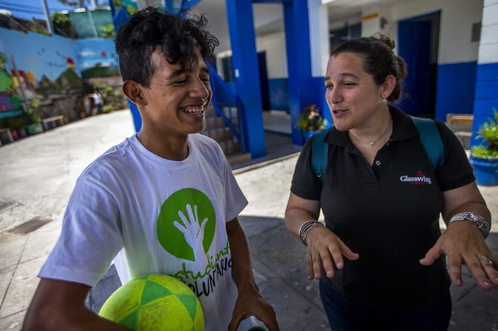 Celina de Sola chats with one of the students at Centro Escolar Republica De Canada in the community of Las Palmas in San Salvador. (Jesse Costa/WBUR)