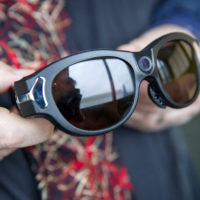 These glasses have a camera built into the bridge over the wearer's nose, so that a remote viewer can see what is happening in front of the person wearing the glasses. (Robin Lubbock/WBUR)