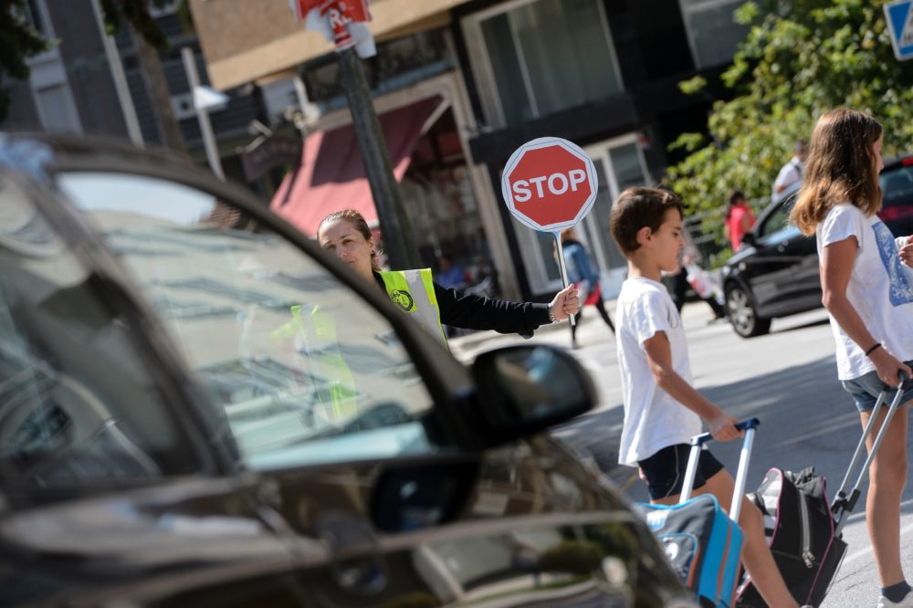 Two kids cross the road as they go to school in the Monteporreiro neighborhood of Pontevedra, northwestern Spain, on Sept. 22, 2016. (Miguel Riopa/AFP/Getty Images)