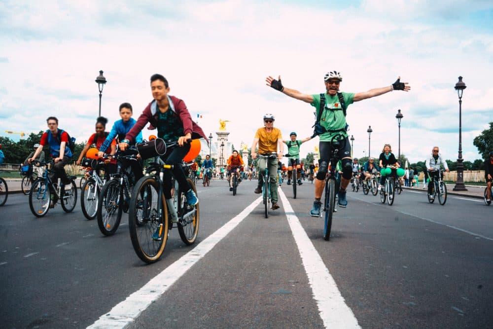 People riding bikes in Paris (FredPixlab/Unsplash)