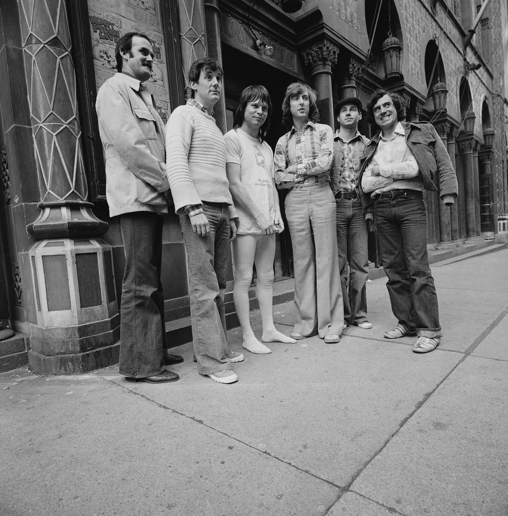 Monty Python members pose outside the City Center building in New York in 1976. From left to right: John Cleese, Michael Palin, Terry Gilliam, Eric Idle, Neil Innes, Terry Jones. (Suzanne Vlamis/AP)