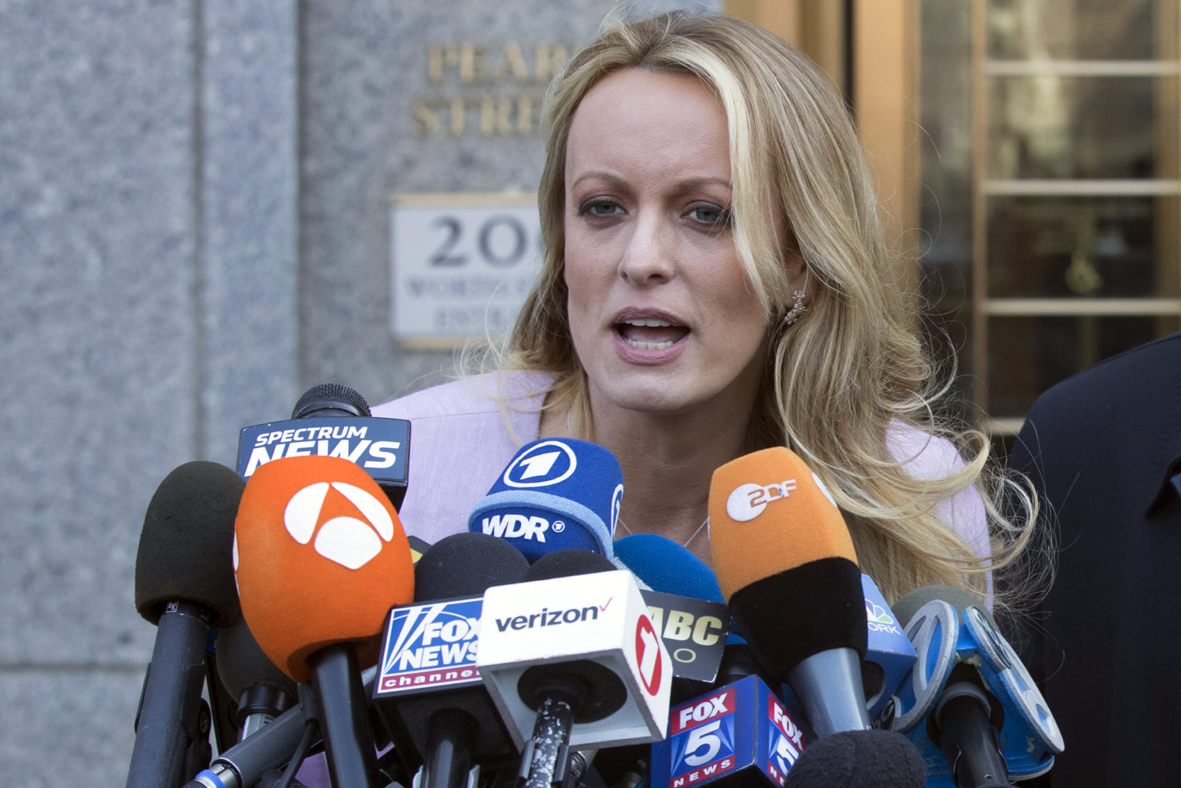 Adult film actress Stormy Daniels speaks outside federal court, Monday, April 16, 2018, in New York. (Mary Altaffer/AP)