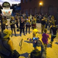The Yes Ma'am Brass Band plays into the evening at HONK! in 2017. (Robin Lubbock/WBUR)