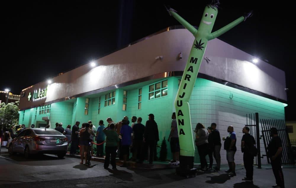 In this July 1, 2017, file photo, people line up at the NuLeaf marijuana dispensary in Las Vegas. (John Locher/AP)