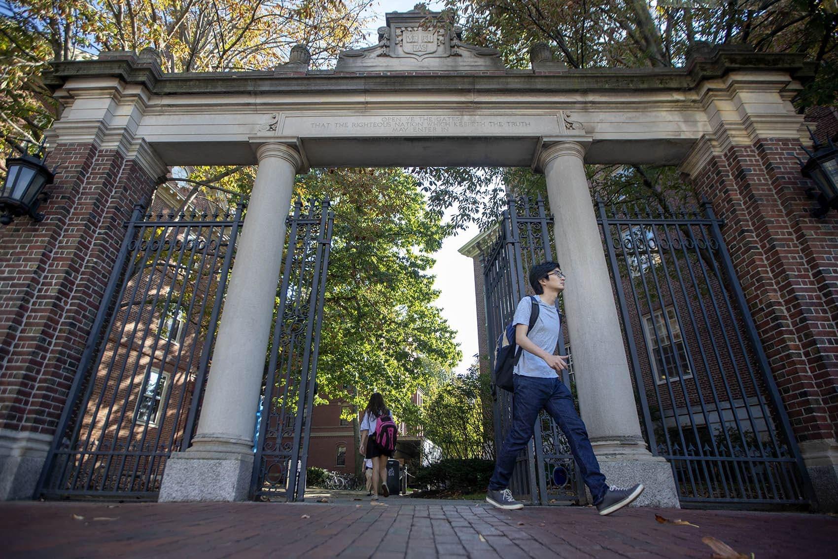 Students walk through the Class of 1875 Gate outside Harvard Yard. (Jesse Costa/WBUR)