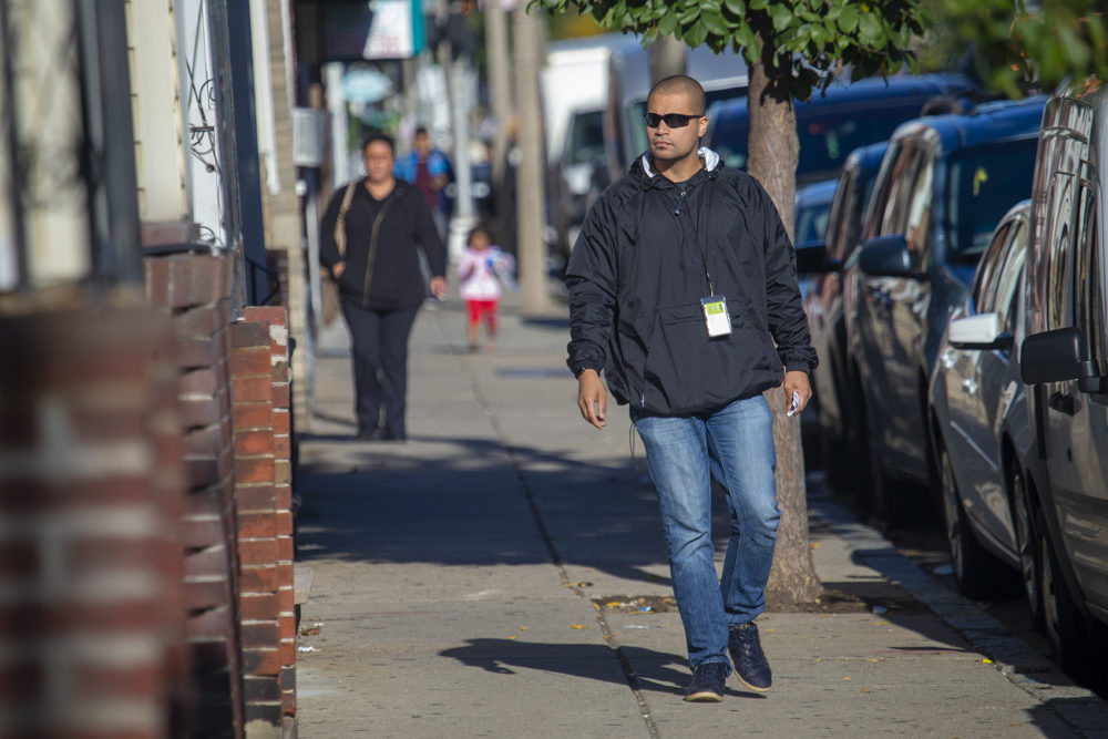 Diego Pizarro, a front line youth worker at Roca, walks down Bennington Street to one of the addresses he obtained from East Boston District Court. (Jesse Costa/WBUR)