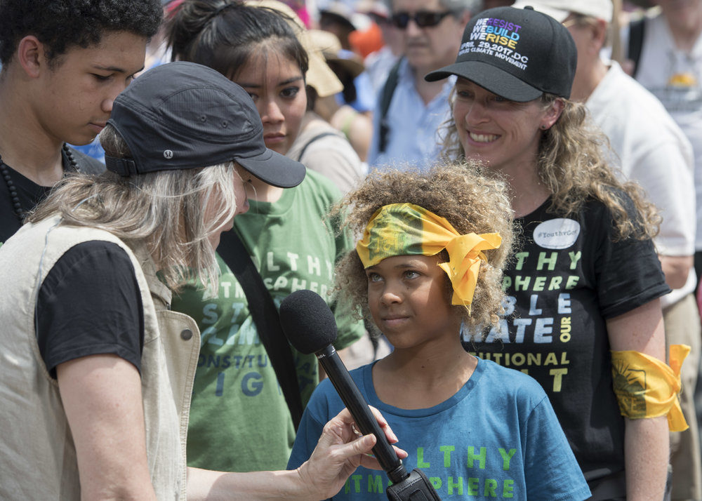 Levi Draheim being interviewed at the People's Climate March in Washington, D.C., in 2017. (Courtesy Robin Loznak)