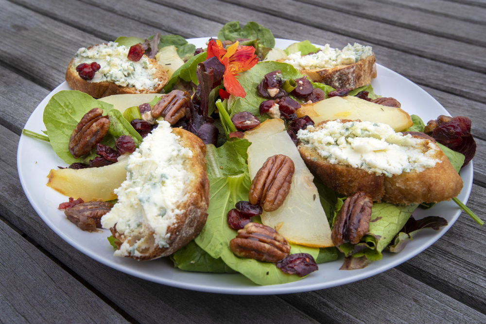 Spinach salad with roasted pears, blue cheese toasts and caramelized maple pecans with sun-dried cranberry vinaigrette. (Jesse Costa/WBUR)
