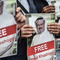 Protesters hold pictures of missing journalist Jamal Khashoggi during a demonstration in front of the Saudi Arabian consulate on Oct. 8, 2018 in Istanbul. (Ozan Kose/AFP/Getty Images)
