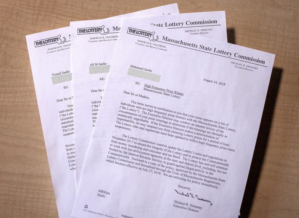 Copies of letters sent by the lottery about its new policy to curb frequent winning to the Jaafars' Watertown home -- a letter each for Ali and his two sons, Mohamed and Yousef. (Robin Lubbock/WBUR)