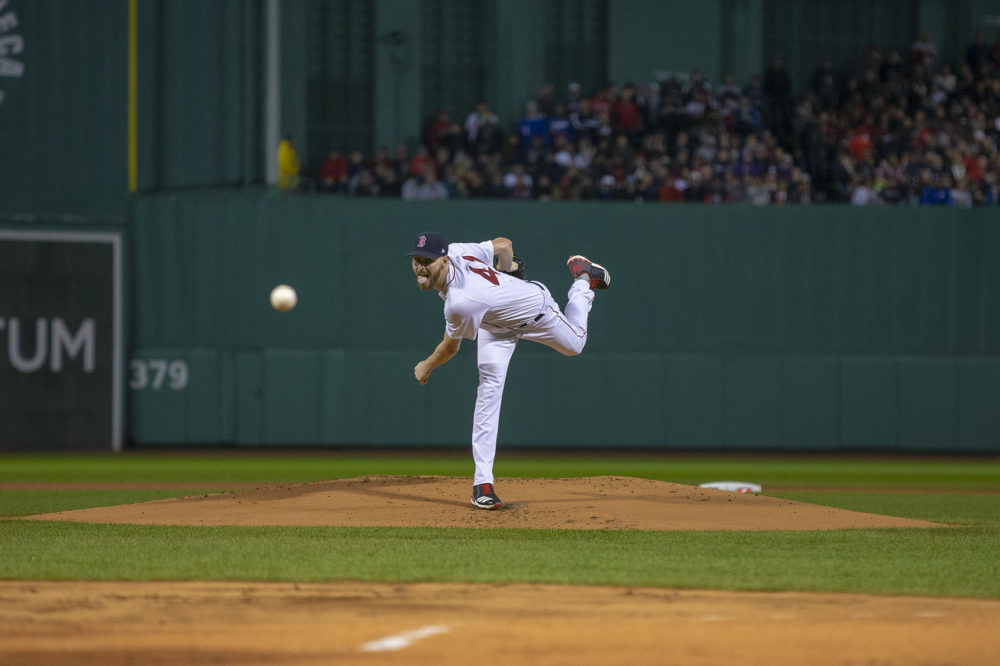 Red Sox pitcher Chris Sale pitches to Dodgers lead off batter Brian Dozier to start the 2018 World Series. (Jesse Costa/WBUR)