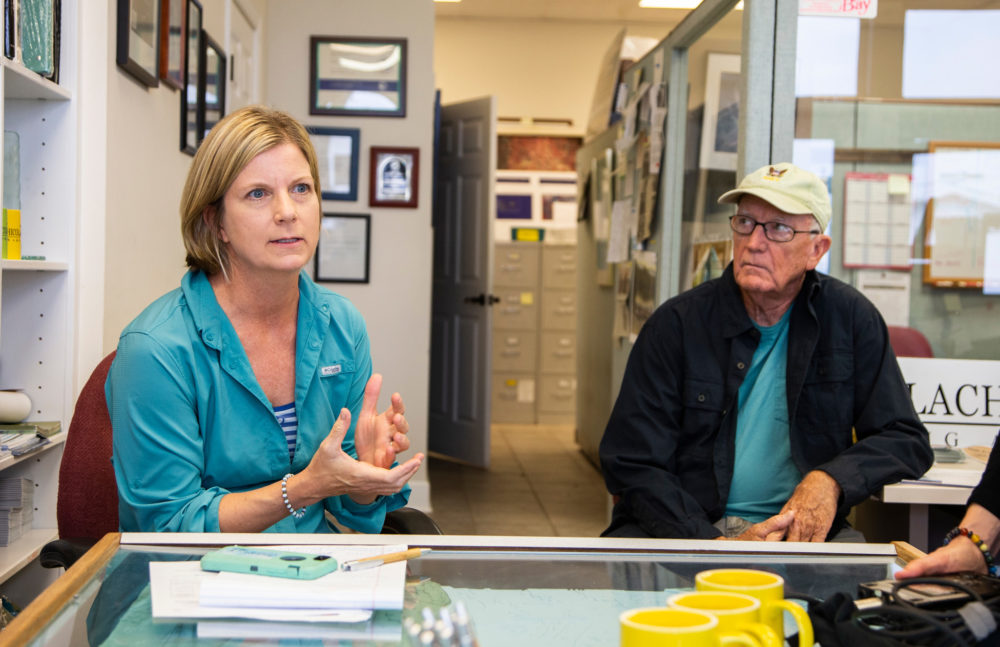Georgia Ackerman (left), Apalachicola riverkeeper, from the nonprofit Waterkeeper Alliance, and Roy Ogles, who recently retired from the Florida Department of Environmental Protection. (Mark Wallheiser for Here & Now)