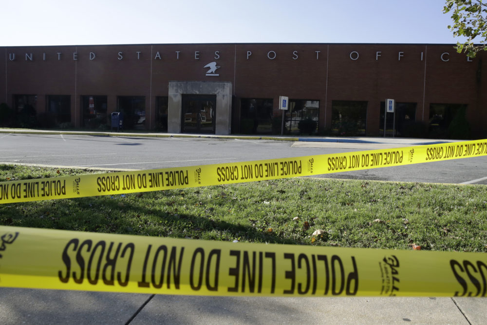 Police tape cordons off a post office in Wilmington, Del., Thursday, Oct. 25, 2018.  A law enforcement official said suspicious packages addressed to former Vice President Joe Biden were intercepted at Delaware mail facilities in New Castle and Wilmington and were similar to crude pipe bombs sent to former President Barack Obama, Hillary Clinton and CNN. (Matt Rourke/AP)