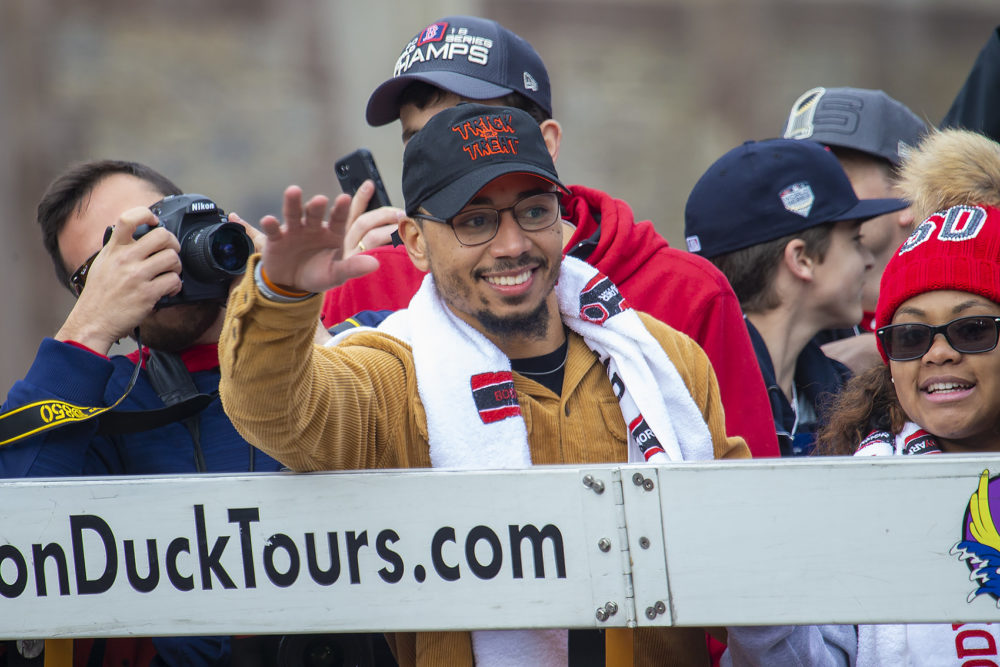 Mookie Betts waves to the crowd. (Jesse Costa/WBUR)