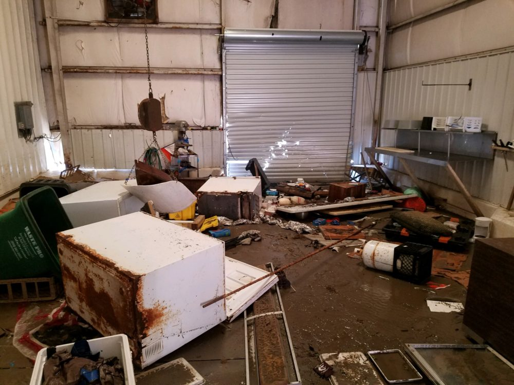 Inside Buddy Ward & Son's Seafood, owned by T.J. Ward's family, in Apalachicola, after Hurricane Michael swept through. (Courtesy T.J. Ward)