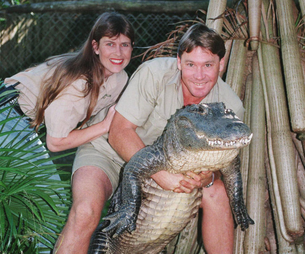 """In this June 18, 1999 file photo, Steve Irwin, """"The Crocodile Hunter"""" holds a nine-foot female alligator accompanied by his American wife Terri at his """"Australia Zoo"""" in Beerwah, Queensland, Australia. In 2006, Steve Irwin was killed by stingray in the waters off Australia while filming. (Russell McPhedran/AP/File)"""