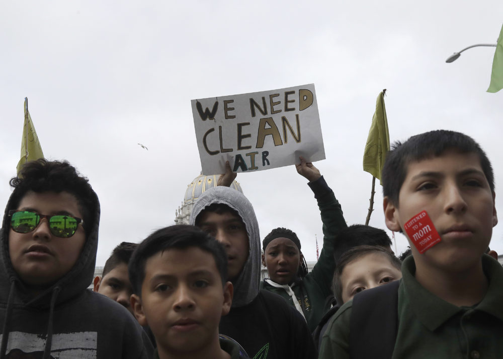 "Students listen to speakers at a rally for clean energy in San Francisco, Wednesday, Feb. 28, 2018. California stands in ""complete opposition"" to a Trump administration plan to scrap a policy slashing climate-changing emissions from power plants. (Jeff Chiu/AP)"