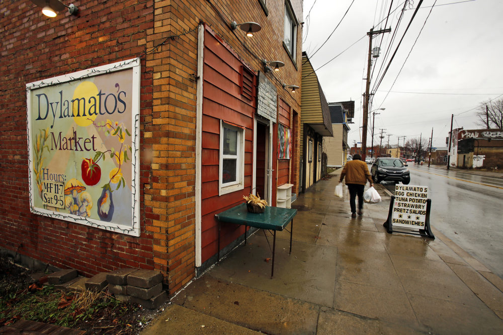 In this March 1, 2018 photo, a customer leaves Dylamatos Market in Pittsburgh. About a quarter of the market's' customers pay with benefits from the federal Supplemental Nutrition Assistance Program. (Gene J. Puskar/AP)