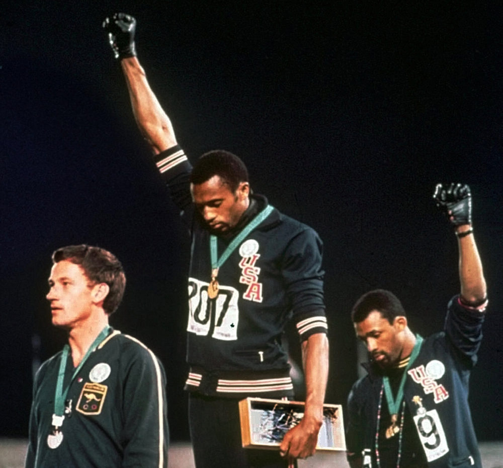 Tommie Smith and John Carlos won gold and bronze, respectively, in the 200-meter run at the 1968 Olympic Games. (AP)