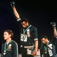 Tommie Smith and John Carlos won gold and bronze, respectively, in the 200-meter run at the 1968 Olympic games. (AP Photo, File)