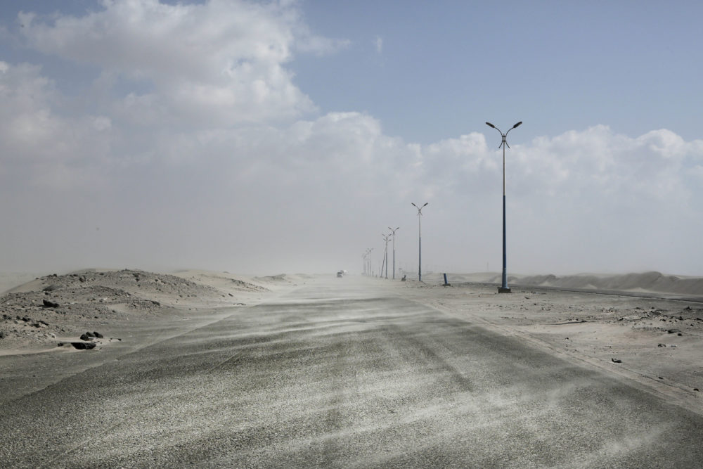 This Feb. 15, 2018, photo shows sand drifting over an empty highway from Abyan to Aden in Yemen. Violence, famine and disease have ravished the country of some 28 million, which was already the Arab world's poorest before the conflict began. (Nariman El-Mofty/AP)