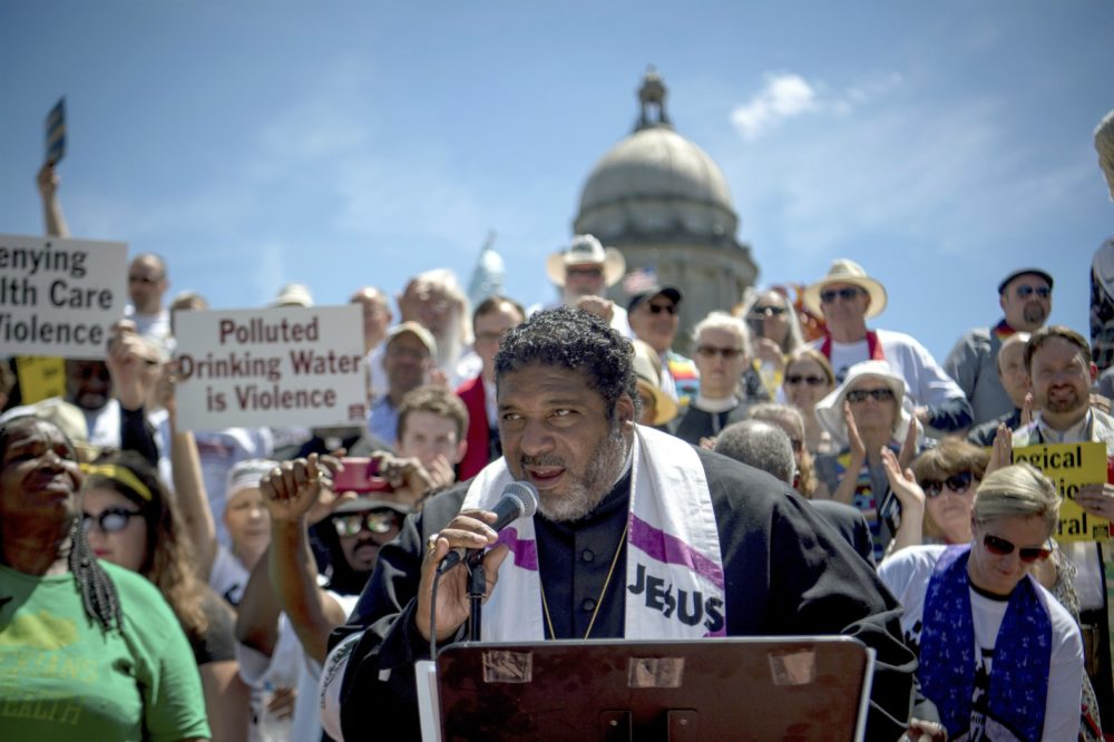 Reverend William J. Barber speaks to protesters gathered during a protest organized by Kentucky Poor People's Campaign in Frankfort, Kentucky, Monday, June 4, 2018 (Bryan Woolston/AP)
