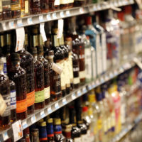 Liquor bottles are seen on display at a grocery store in River RIdge, La., Wednesday, July 11, 2018. (AP Photo/Gerald Herbert)