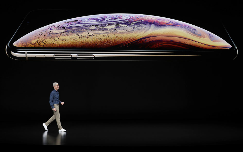 Apple CEO Tim Cook speaks about the Apple iPhone XS at the Steve Jobs Theater during an event to announce new Apple products Wednesday, Sept. 12, 2018, in Cupertino, Calif. (Marcio Jose Sanchez/AP)