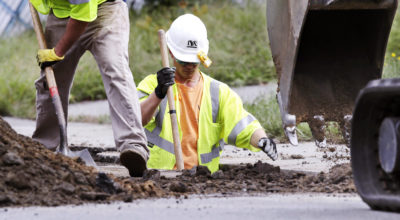 Utility contractors dig up the road above natural gas lines along Dracut Street in Lawrence, Mass., Thursday, Sept. 20, 2018 after the explosions in the Merrimack Valley area serviced by Columbia Gas of Massachusetts. (Charles Krupa/AP)