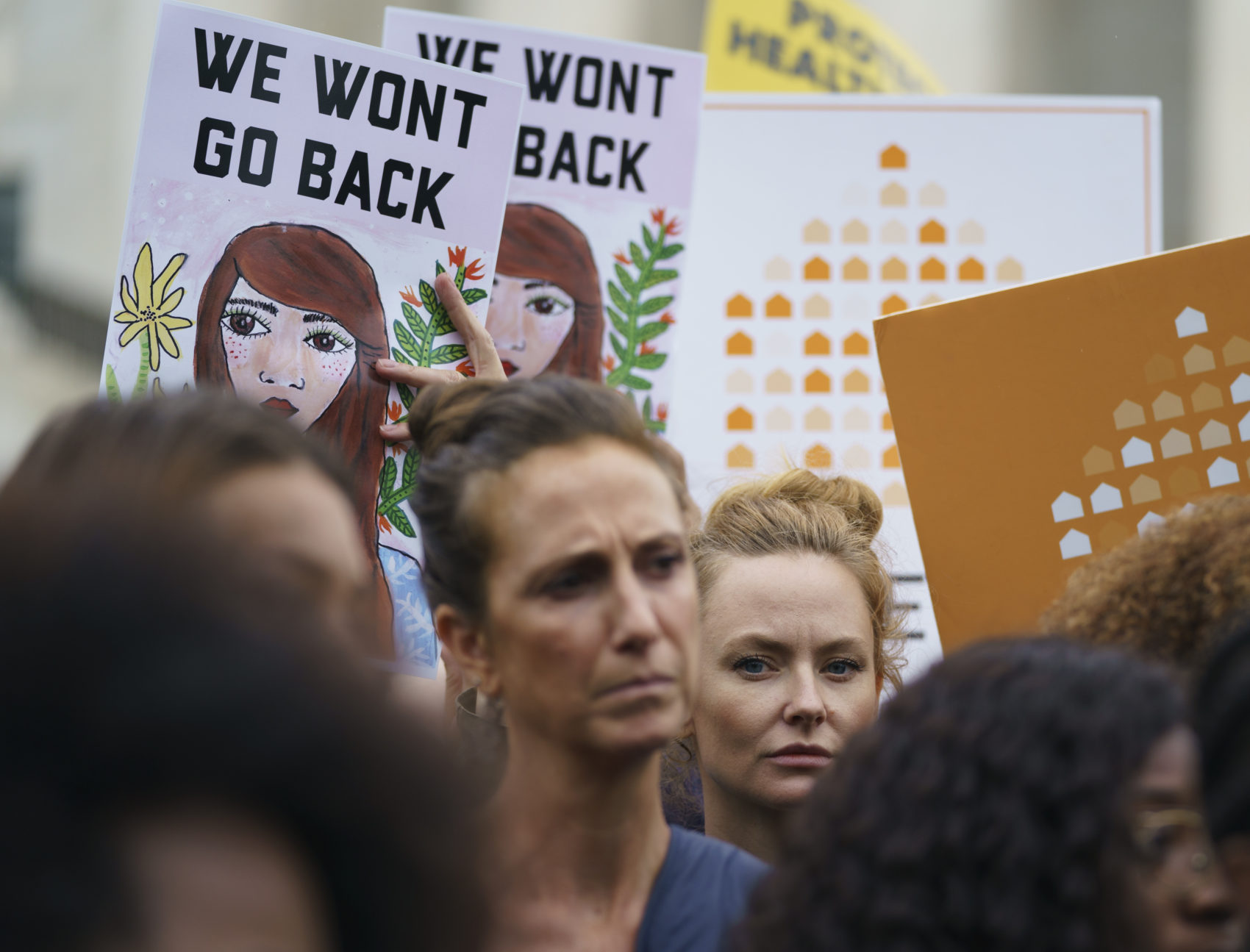 "Protesters with Women's March and others hold up signs that read ""We Won't Go Back"" as they gather in front of the Supreme Court on Capitol Hill in Washington, Monday, Sept. 24, 2018. (Carolyn Kaster/AP)"