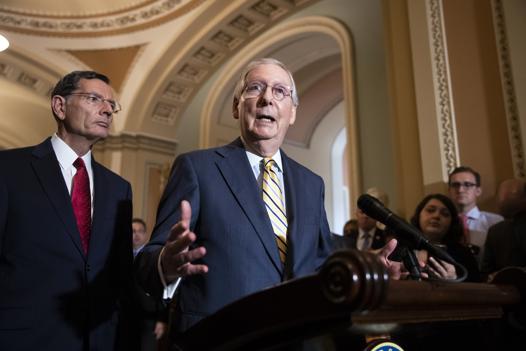 Senate Majority Leader Mitch McConnell, R-Ky., joined at left by Sen. John Barrasso, R-Wyo., speaks to reporters about the political battle for confirmation of President Donald Trump's Supreme Court nominee, Brett Kavanaugh, following a closed-door GOP policy meeting, at the Capitol in Washington, Tuesday, Oct. 2, 2018. (AP Photo/J. Scott Applewhite)