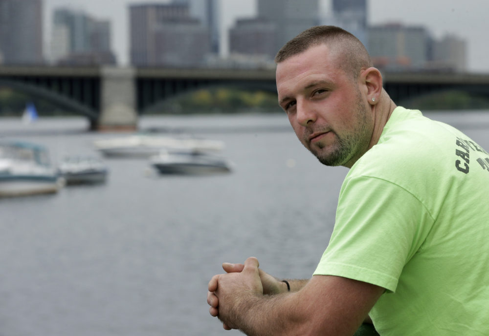 In this Monday, Oct. 1, 2018 photo Michael Robinson, of North Reading, Mass., in recovery from heroin addiction, stands for a photo near the Charles River, in Cambridge. Robinson recently became a union carpenter and has been working on building projects across the Boston area since. (Steven Senne/AP)