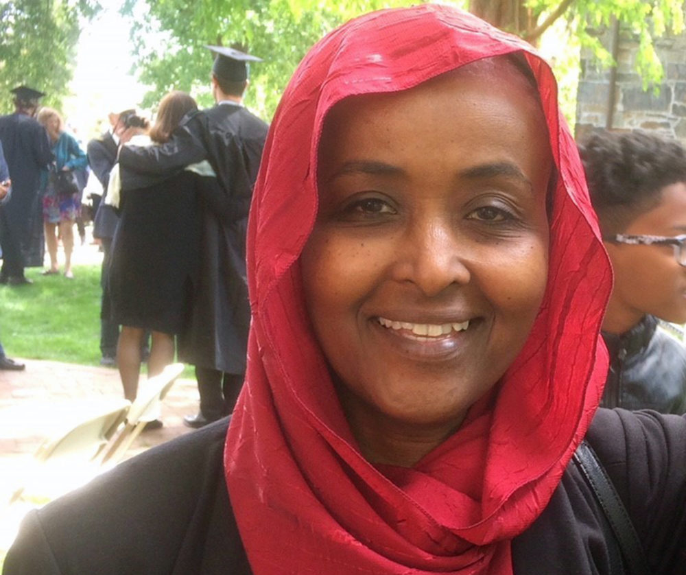 This May 21, 2017, photo provided by Hiwaida Elarabi and Iman Ahmed shows Elarabi at a graduation ceremony in Medford, Mass. When Elarabi, a Sudanese immigrant, learned the U.S. government was ending the temporary protected status that allowed her to live and work in the country legally for two decades, she sold off the restaurant that had been her life's dream. (Iman Ahmed/Courtesy of Hiwaida Elarabi via AP)